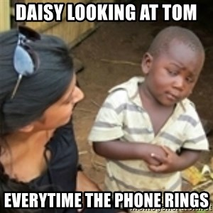 Skeptical african kid  - Daisy looking at Tom  everytime the phone rings