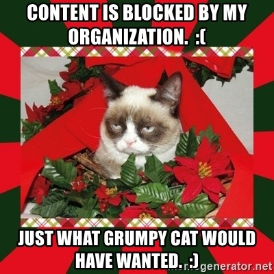 GRUMPY CAT ON CHRISTMAS - Content is blocked by my organization.  :(  Just what grumpy Cat would have wanted.  :)