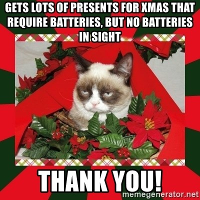 GRUMPY CAT ON CHRISTMAS - Gets lots of presents for xmas that require batteries, but no batteries in sight THANK YOU!