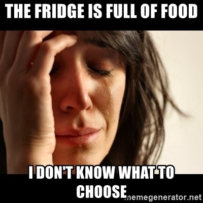 crying girl sad - the fridge is full of food I don't know what to choose