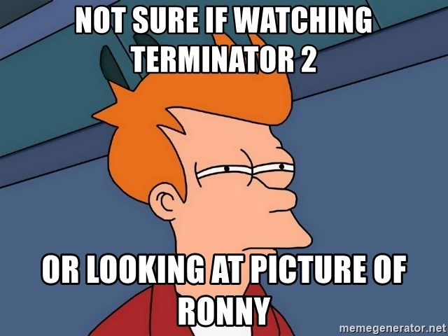 Futurama Fry - not sure if watching terminator 2 or looking at picture of ronny