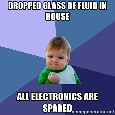 Success Kid - Dropped glass of fluid in house all electronics are spared