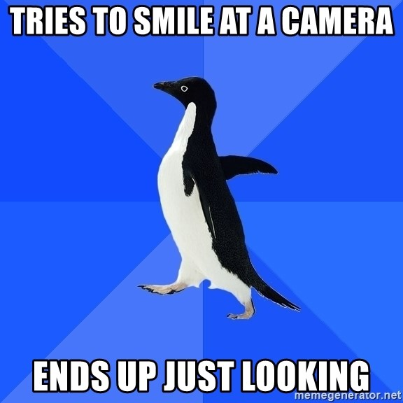 Socially Awkward Penguin - tries to smile at a camera ends up just looking