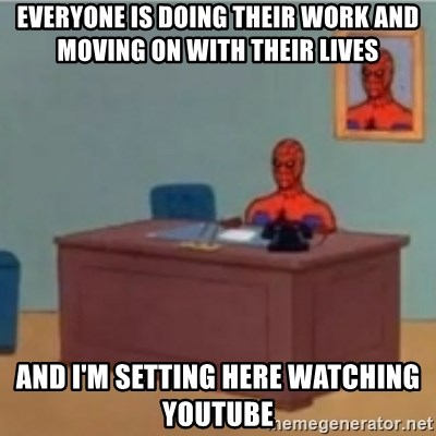 60s spiderman behind desk - everyone is doing their work and moving on with their lives and I'm setting here watching youtube
