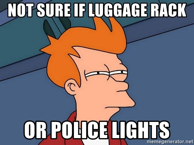 Futurama Fry - not sure if LUGGAGE rack or police lights