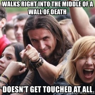Ridiculously Photogenic Metalhead - walks right into the middle of a wall of death doesn't get touched at all