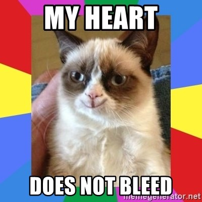 Grumpy Cat Smiling - my heart does not bleed