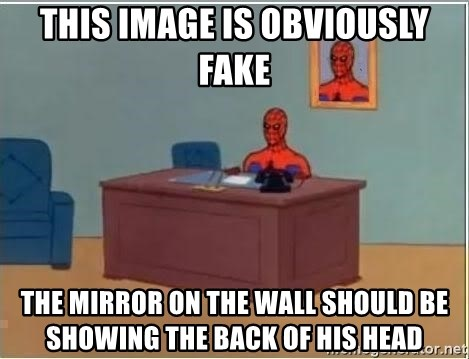 Spiderman Desk - this image is obviously fake the mirror on the wall should be showing the back of his head