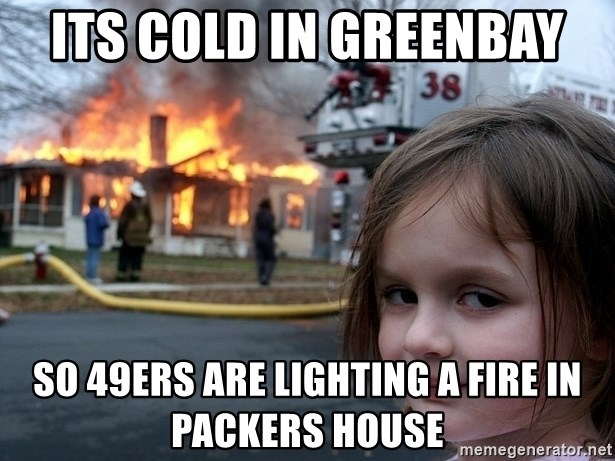 Disaster Girl - its cold in Greenbay so 49ers are lighting a fire in packers house