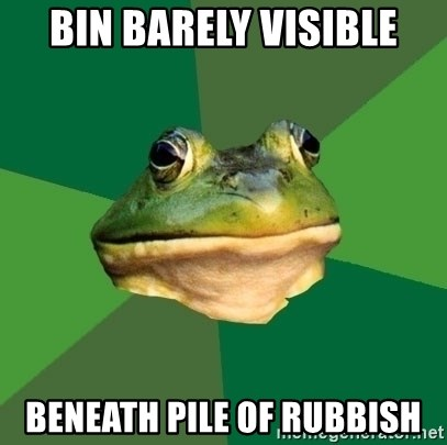 Foul Bachelor Frog - bin barely visible beneath pile of rubbish