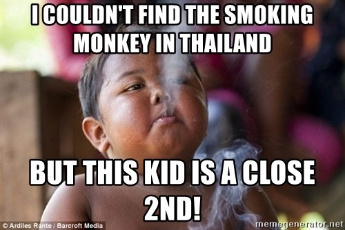 Smoking Baby - I COULDN'T FIND THE SMOKING MONKEY IN THAILAND BUT THIS KID IS A CLOSE 2ND!