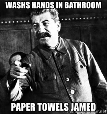 He Mad - WaShs hands in bathroom Paper towels Jamed