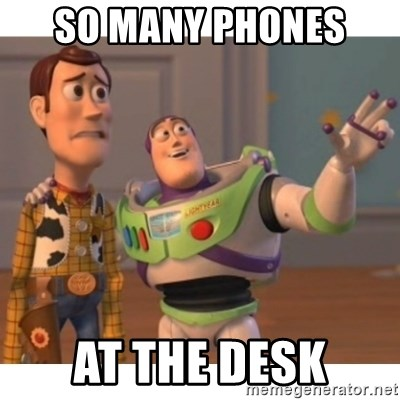 Toy story - So many phones  at the desk