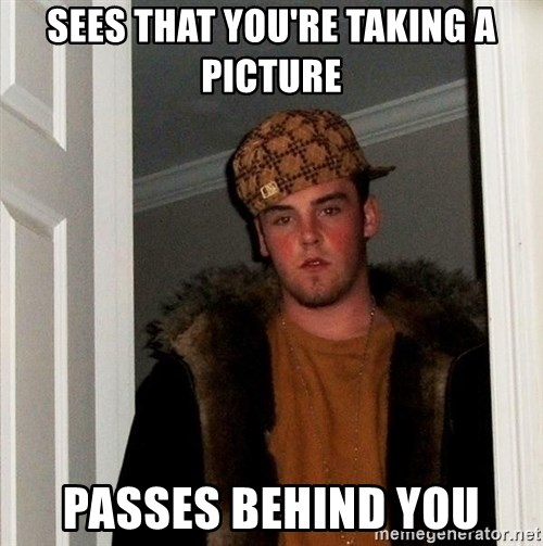 Scumbag Steve - sees that you're taking a picture passes behind you