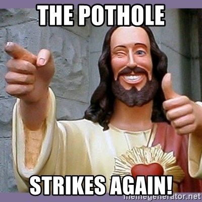 buddy jesus - the pothole strikes again!