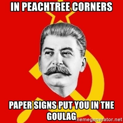 Stalin Says - In Peachtree Corners Paper signs put you in the Goulag