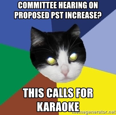Winnipeg Cat - COMMITTEE HEARING ON       PROPOSED PST INCREASE?      THIS CALLS FOR KARAOKE