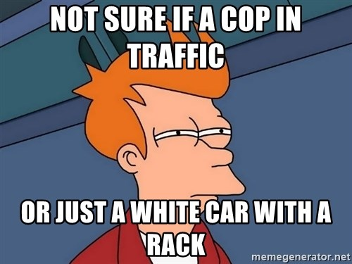 Futurama Fry - not sure if a cop in traffic or just a white car with a rack