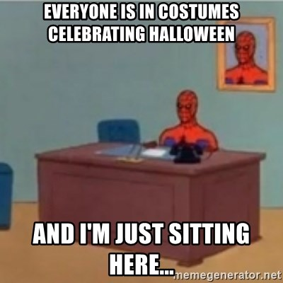 60s spiderman behind desk - EVERYONE IS IN COSTUMES CELEBRATING HALLOWEEN AND I'M JUST SITTING HERE...