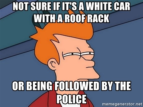 Futurama Fry - not sure if it's a white car with a roof rack or being followed by the police