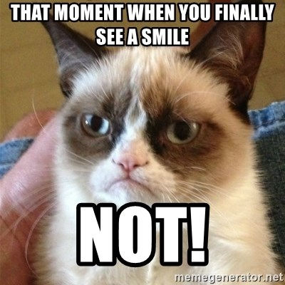 Grumpy Cat  - That moment when you finally see a smile Not!