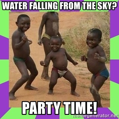 african kids dancing - water falling from the sky? party time!