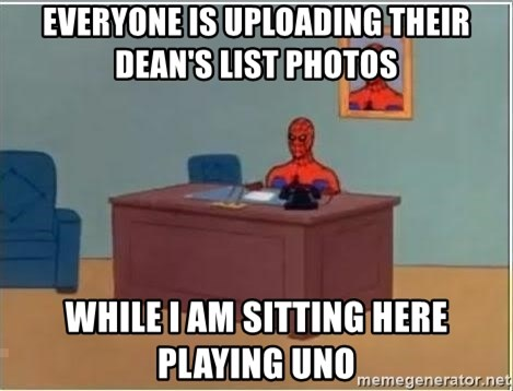 Spiderman Desk - everyone is uploading their Dean's list photos while i am sitting here playing uno