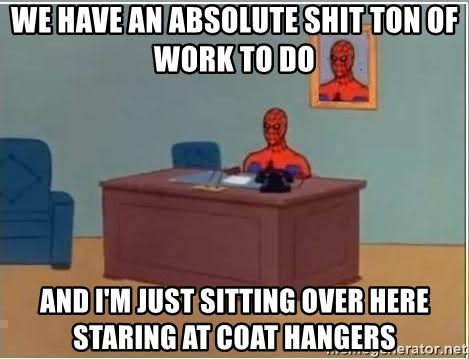 Spiderman Desk - We have an absolute shit ton of work to do and I'm just sitting over here staring at coat hangers