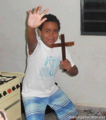 Scared Kid Holding a Cross -