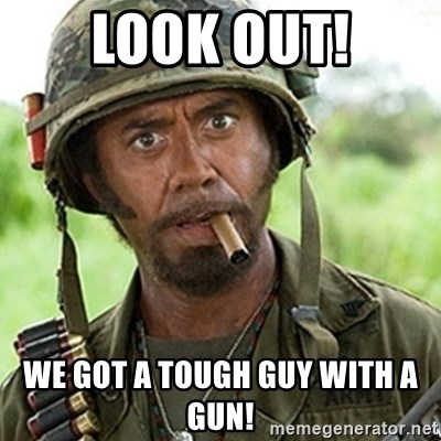 65729311 look out! we got a tough guy with a gun! tropic thunder downey